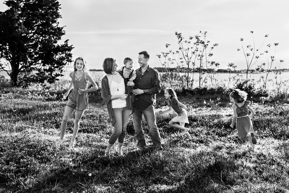 children running around parents in field lifestyle family photography ct