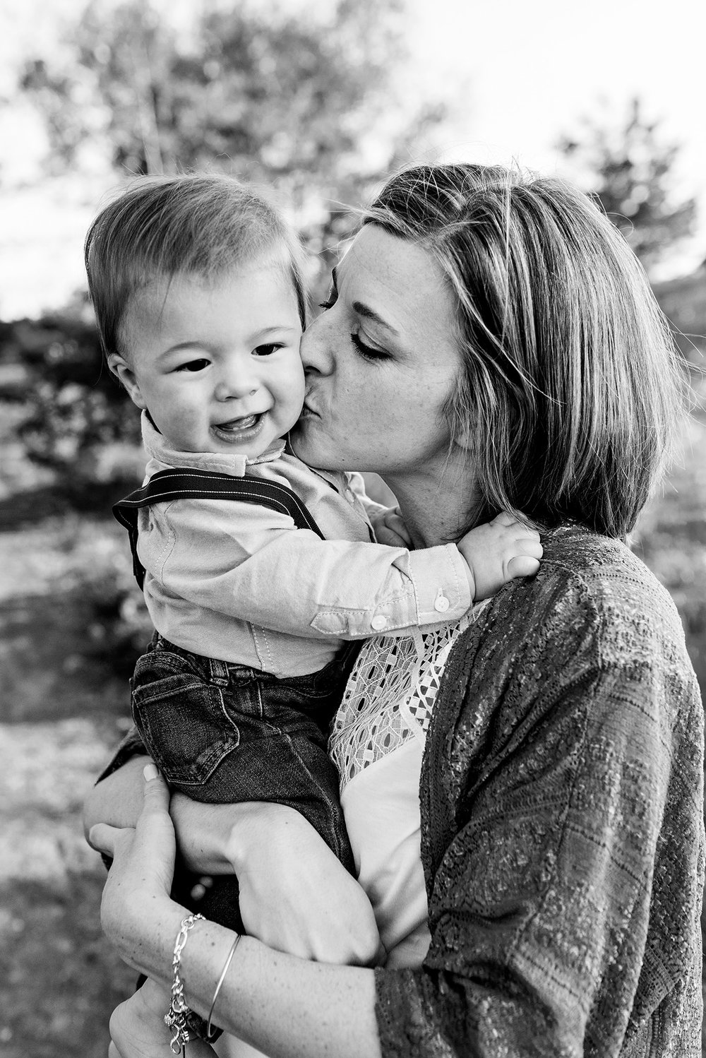 mom kissing son candid family photography ct