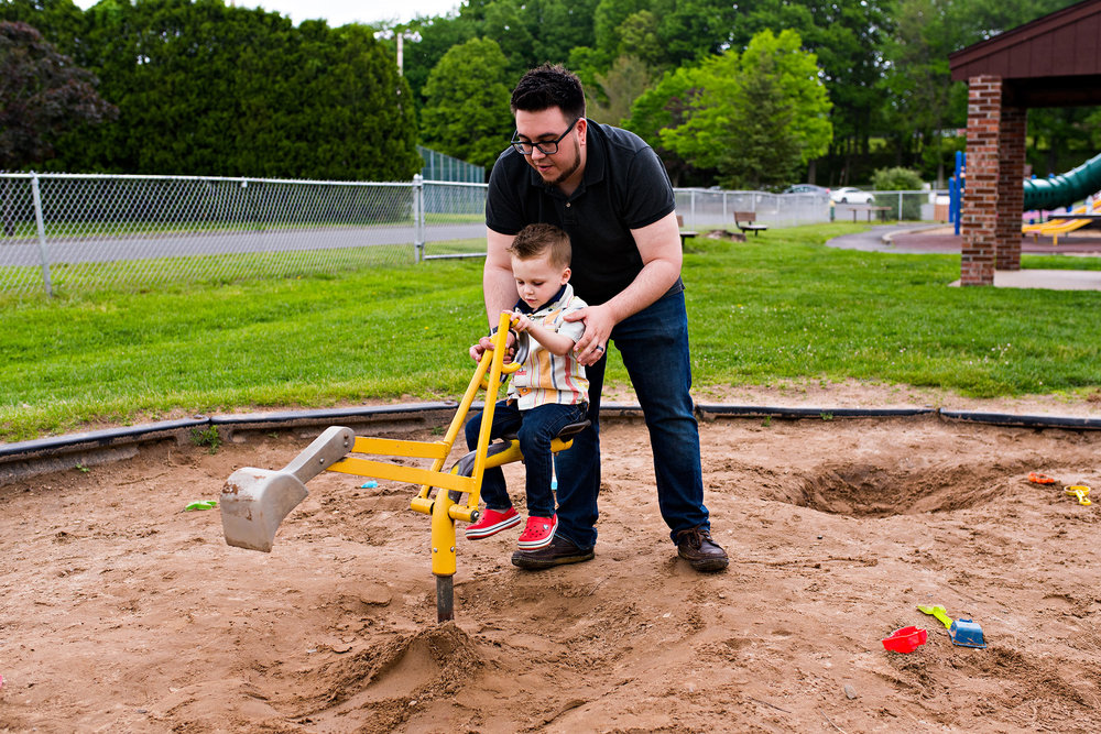 dad playing in sandbox with son documentary family photography ct