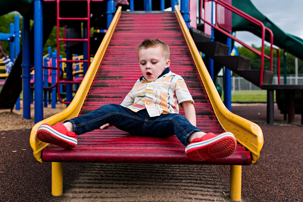 boy going down slide connecticut family photography
