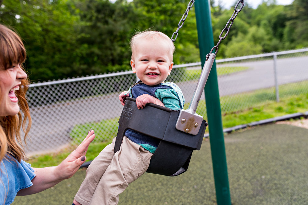 baby on swing at park family photographer ct