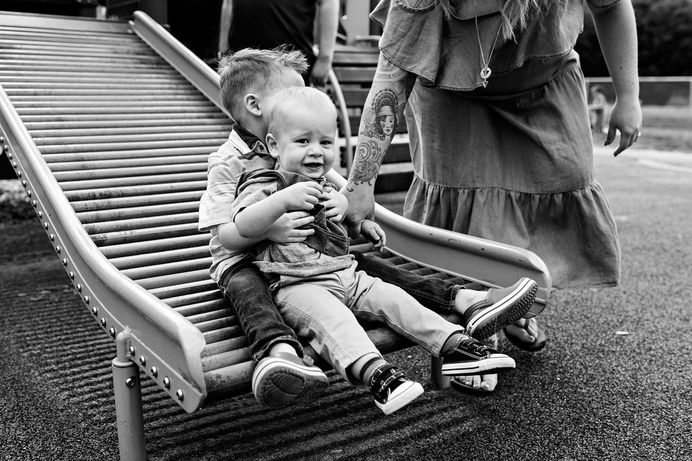 brothers on slide at park family photography ct
