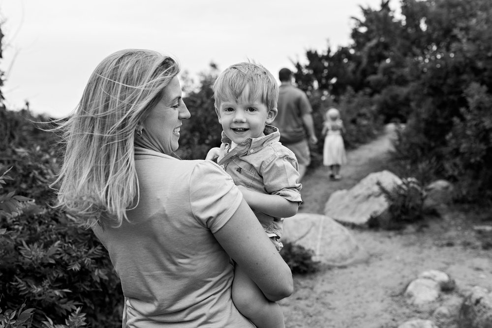 mom holding son laughing clinton, ct beach lifestyle family photographer