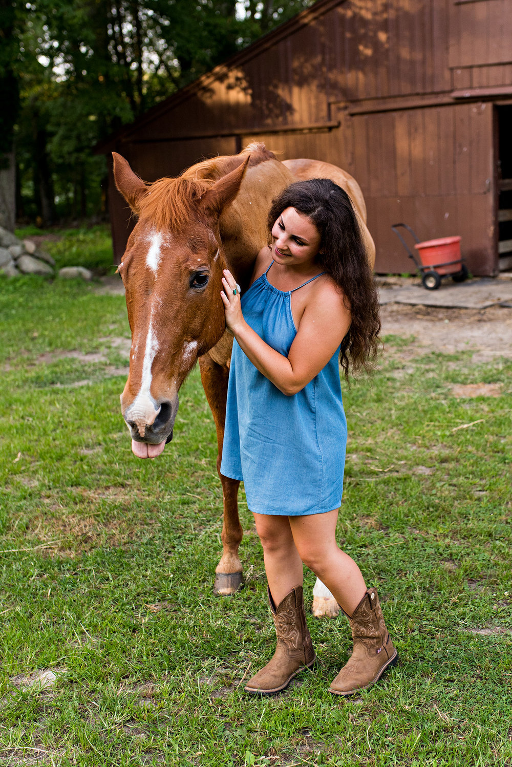 connecticut high school senior portrait photography with a horse on a farm