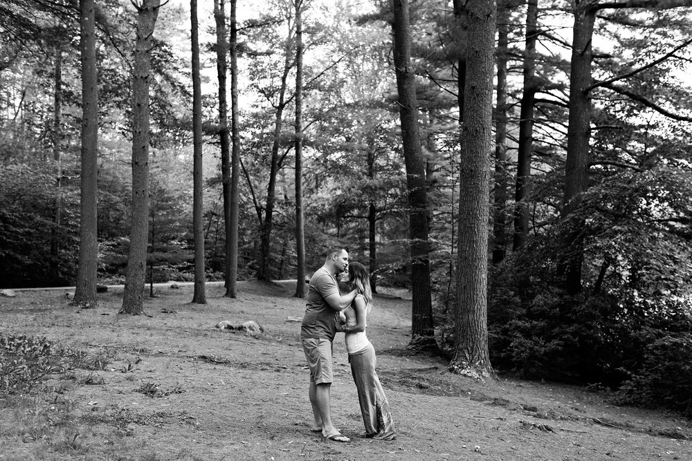 husband and wife kissing in the forest. ct elopment photogtaphy