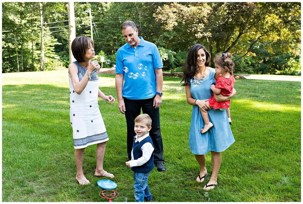 large family photography blowing bubbles with grandma fairfield county photographer