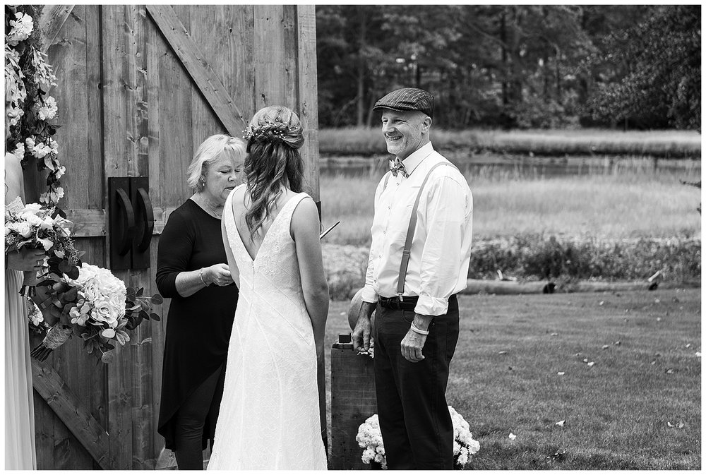 groom smiling at bride saying vows at backyard wedding in connecticut