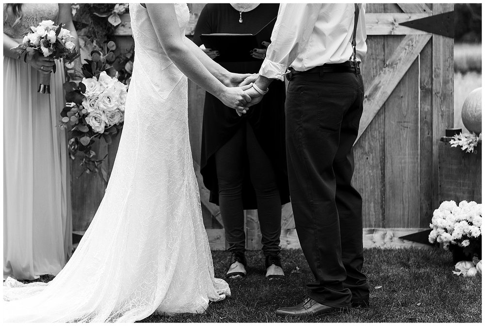 bride and groom holding hands in intimate backyard wedding in connecticut