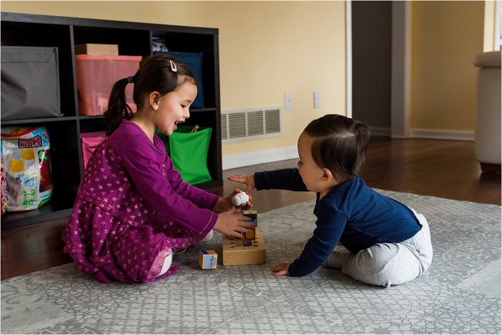 baby brother and sister playing during in home family photography connecticut