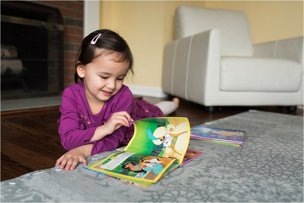 toddler reading book in home lifestyle family photography ct