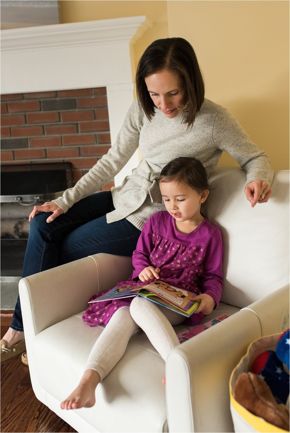 mom and toddler reading in home family photography ct