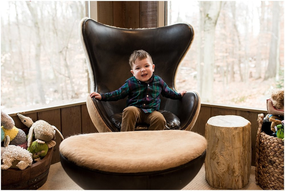 toddler boy giggling in chair. ct newborn photographer