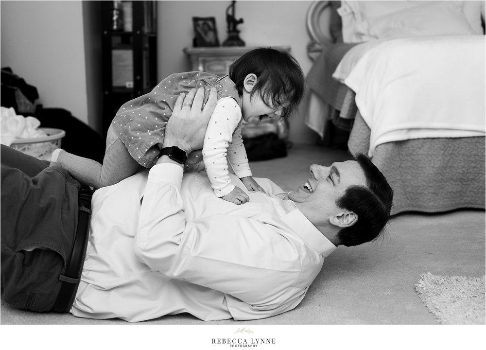 dad playing with daughter. in home photos. maternity pictures ct