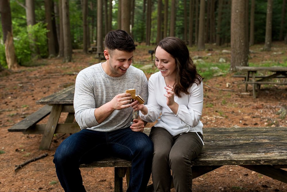 ct engagement photography eating s'mores in the woods