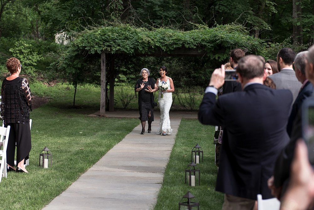 bride walking down isle in connecticut intimate wedding