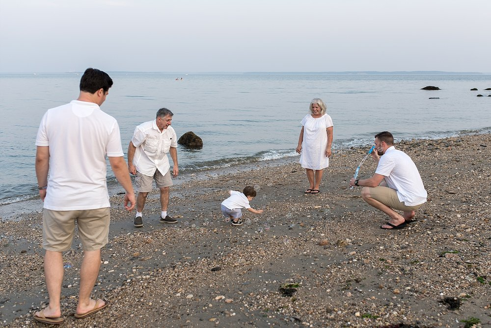 large family photography session on the beach in ct