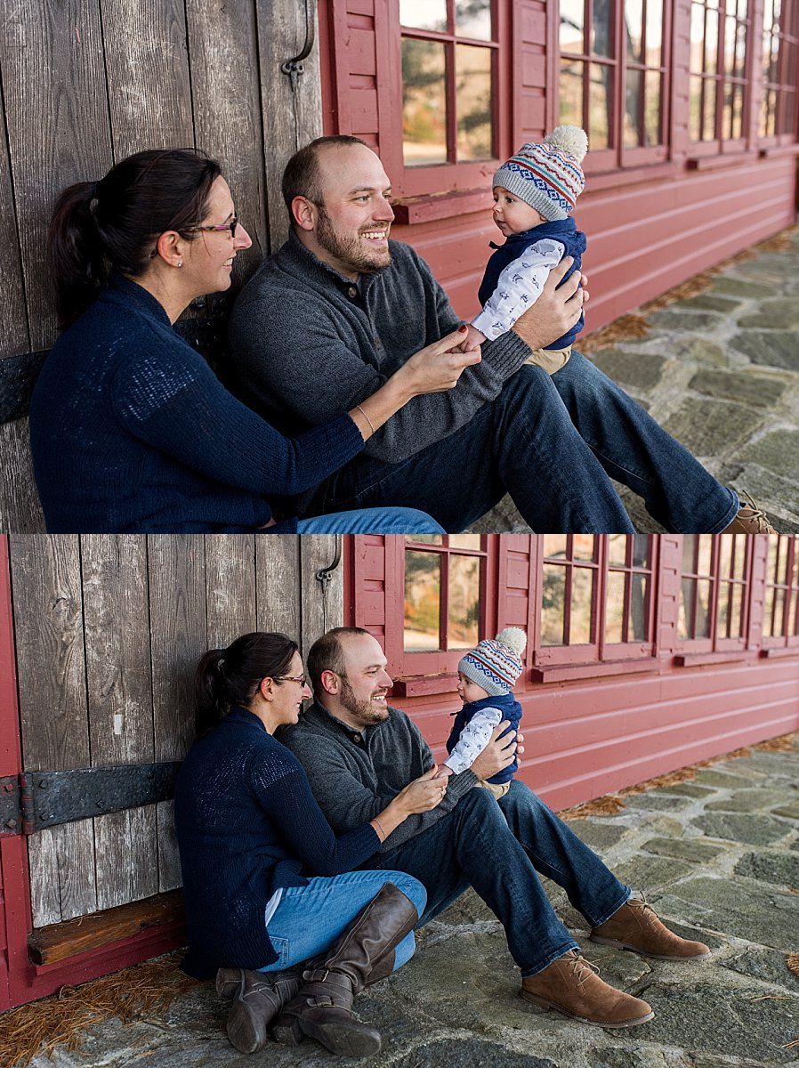 Mom and Dad sitting with baby boy at CT family photography session.