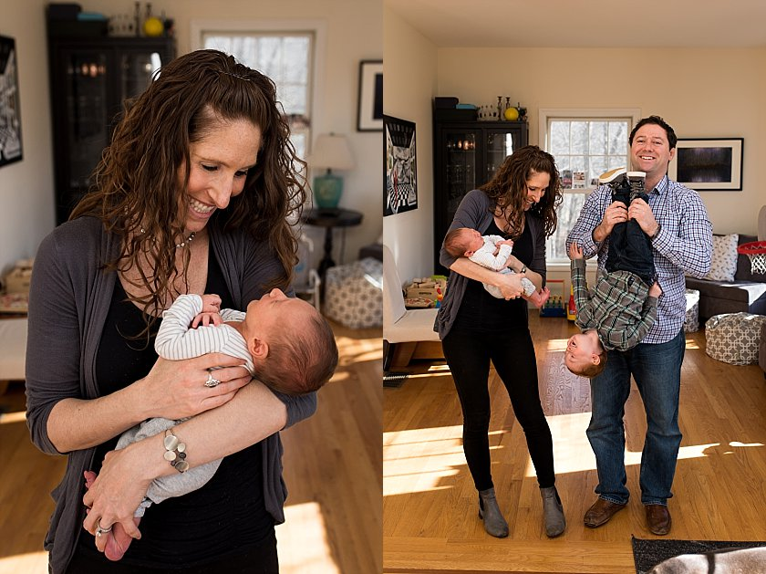 family posing for newborn photography in their home. connecticut lifestyle newborn photographer.