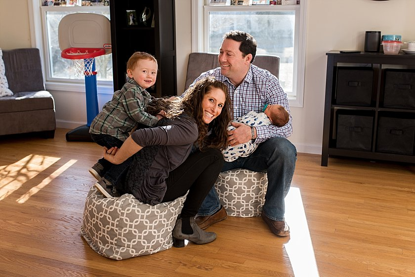 family being silly and funny during their newborn photography session in their home.