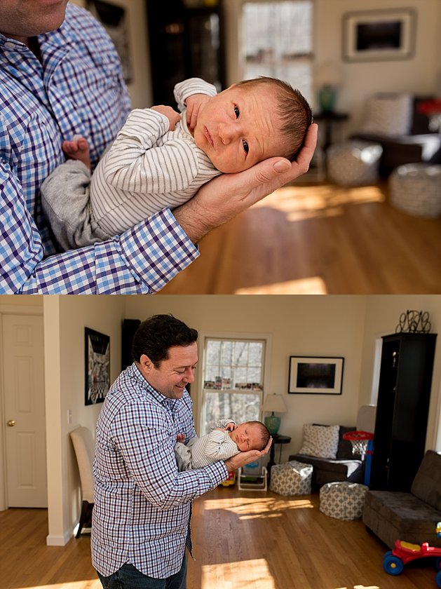 Dad posing with newborn baby boy during their at home newborn photography session. Connecticut newborn photographer.