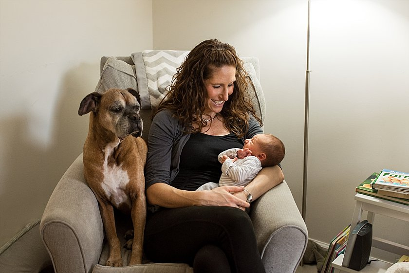 Mom posing with dog and baby boy during their Connecticut newborn photography session.