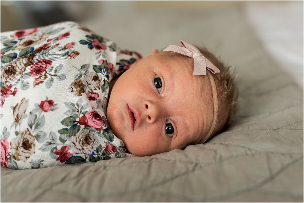 Connecticut newborn in floral swaddled with headband.
