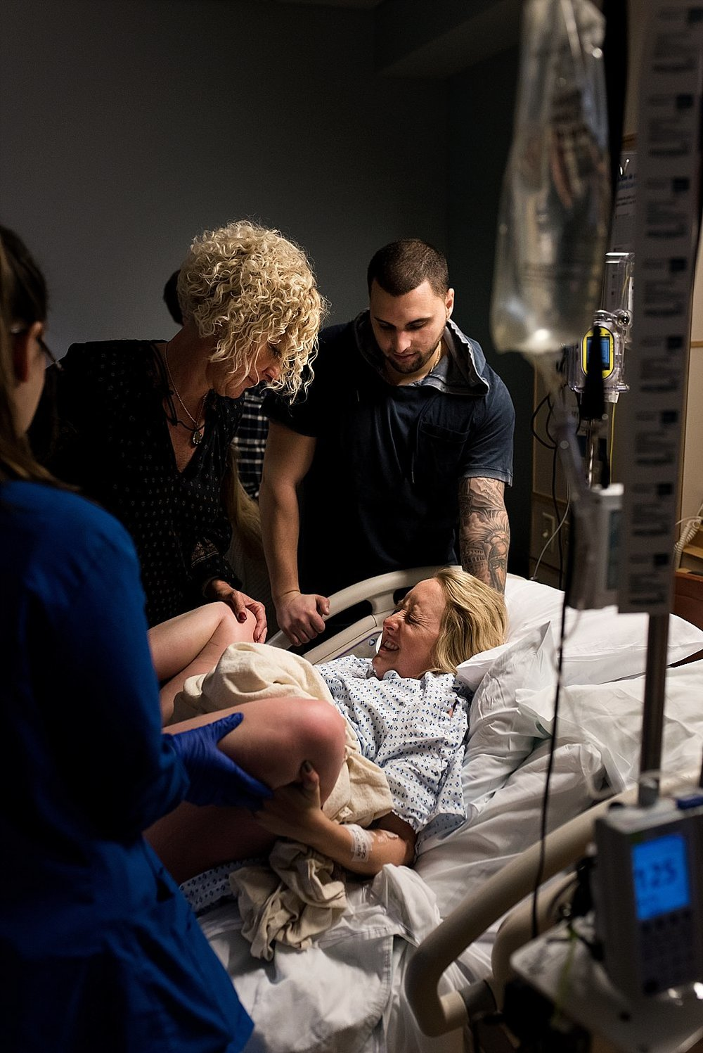 Mom giving birth to baby boy with Connecticut birth photographer.