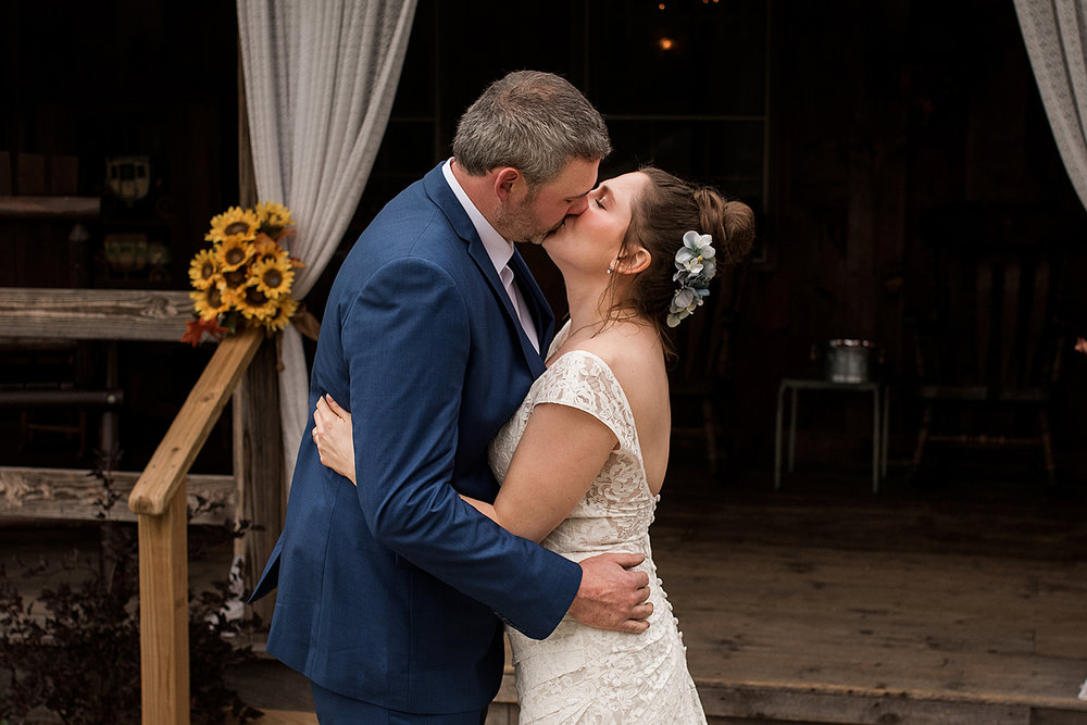 bride and groom first kiss at central ct wedding, with ct wedding photographer