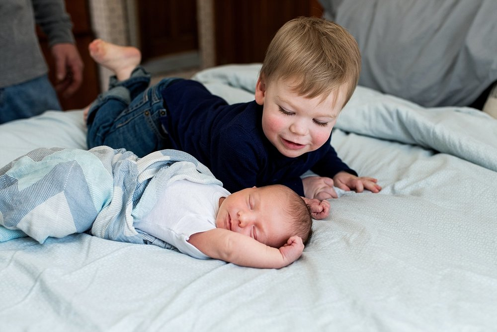 big brother with baby birther during baby photography ct