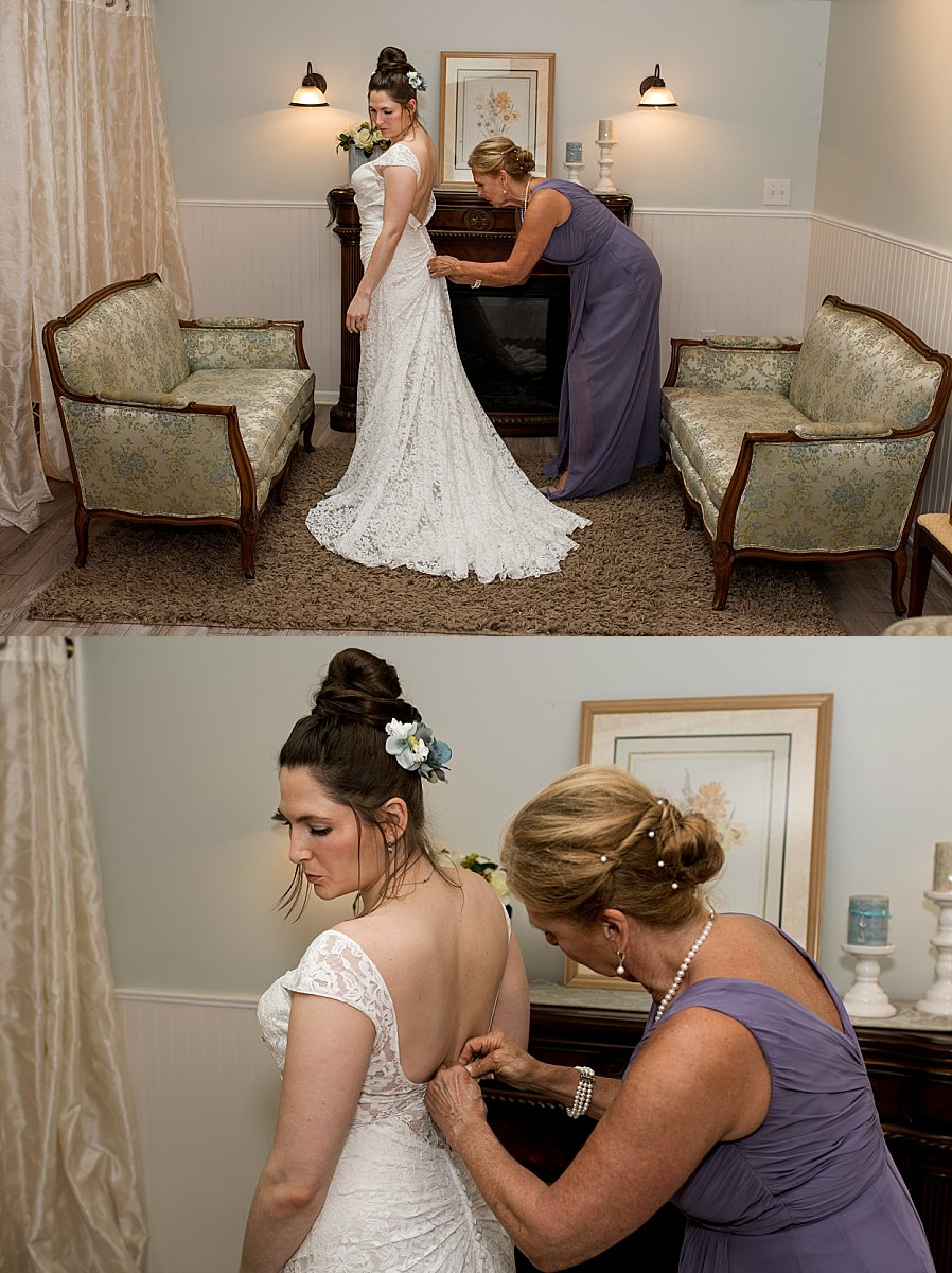 Mother button up her daughter's wedding gown at wood acres farm