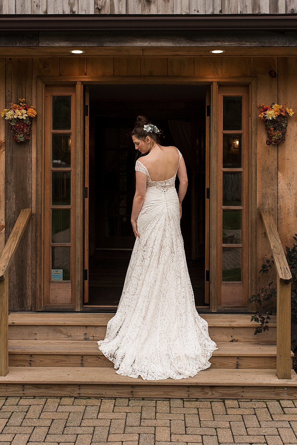 Bride showing off the back of her wedding dress in ct wedding photography