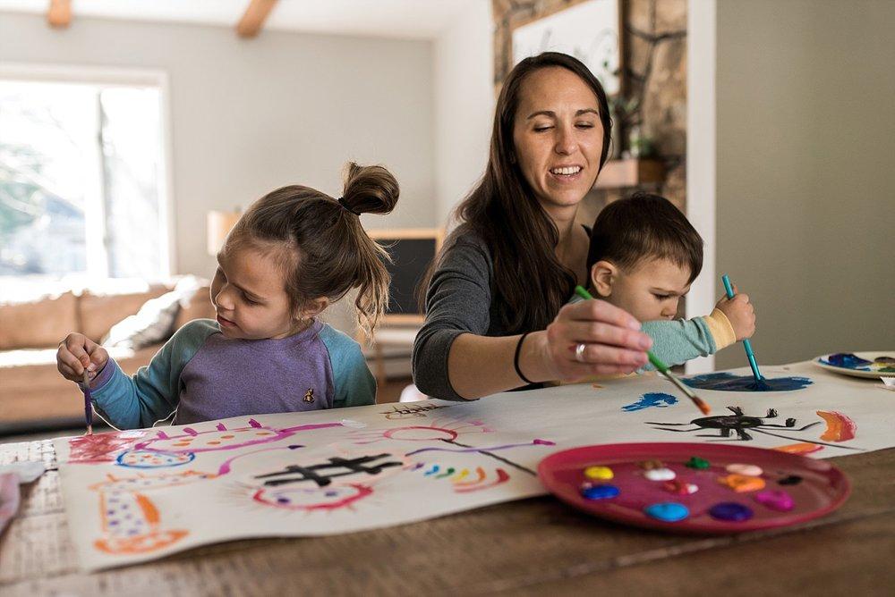 mom painting with children during lifestyle family photography CT