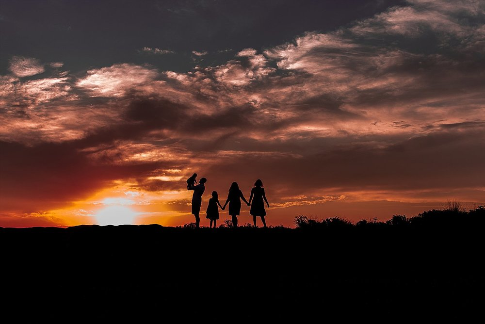 Family silhouette photography at sunset during photo session in Madison, CT