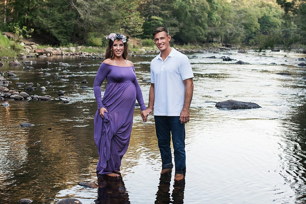 Husband and wife during maternity photography session in Connecticut. Maternity and newborn photography package.