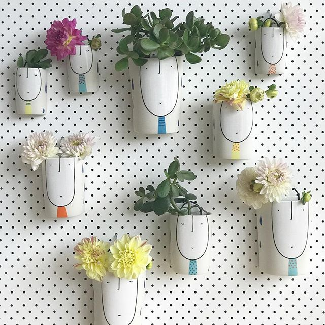 Wall planter/vase guys. The ones with succulents have a drainage hole, the flowers don't. Coming up in my April Shop Update next week. Follow the link in my profile for info.