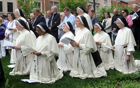 For Pope John Paul, II beatification is an intermediate step toward sainthood in the Roman Catholic Church.  Local catholics, some o