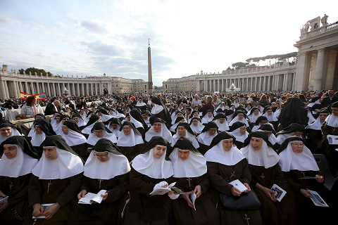 Nuns wait for Pope Francis to lead Mass for canonization in St. Peter's Square at Vatican