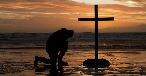 25991-cross-bow-kneel-kneeling-pray-praying-bowing-beach.1200w.tn_.jpg
