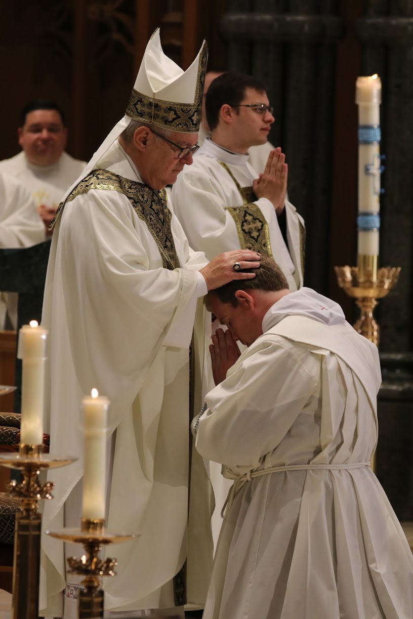 Bishop Tobin lays hands upon Father Brian Morris at the Ordination Mass, Cathedral of Saints Peter & Paul, Providence, June 2017