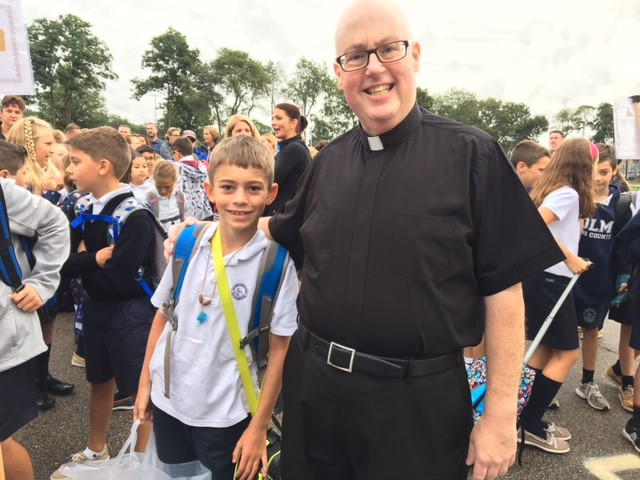 Fr Healey joins OLM 4th Grade Student RyanPedro on First Day of School!