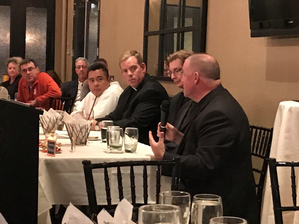 Father David Gaffney (far right) offers a response during OLM's recent  Grill the Priests  event held on Wednesday, October 18 at 1149 Restaurant in East Greenwich. Joining him on the panel were Father Nicanor Austriaco, OP, Father Brian Morris, Father Joshua Barrow and (hidden from view) Father Adam Young.