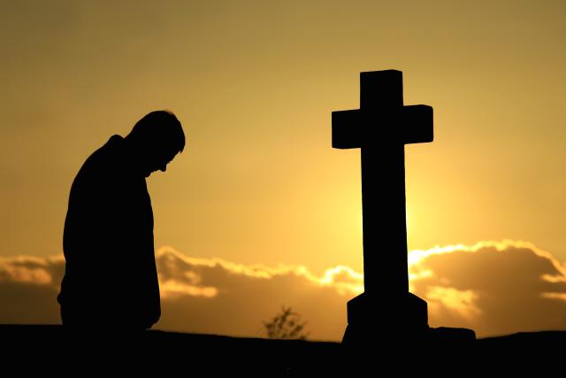 Man-at-Grave-at-Sunset-1500.jpg