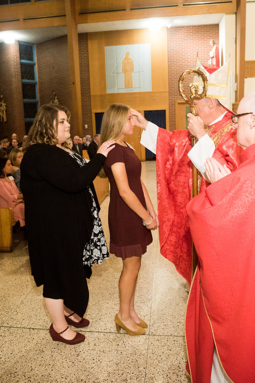 Catherine Clements is confirmed by Bishop Checchio.
