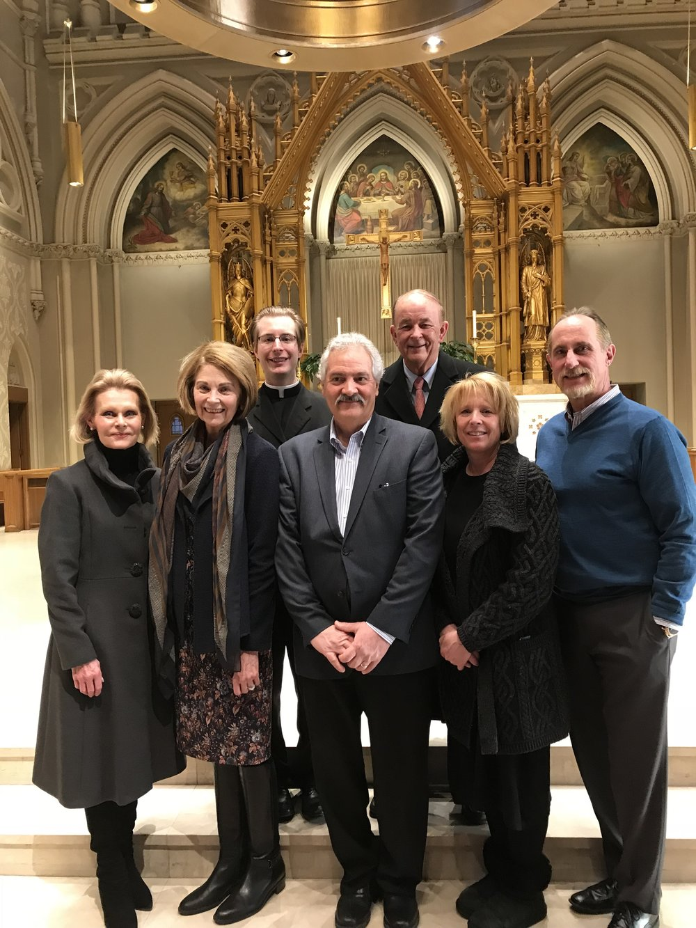 The Rite of Election at the Cathedral, Sunday, February 18.  Left to Right: RCIA Team Members Carol Jones, Mary Anne Weaver, Fr. Barrow, Candidate Al Behbehani, RCIA Team Member Don Jones, Candidate Sue Healey and her husband, Mike Healey.