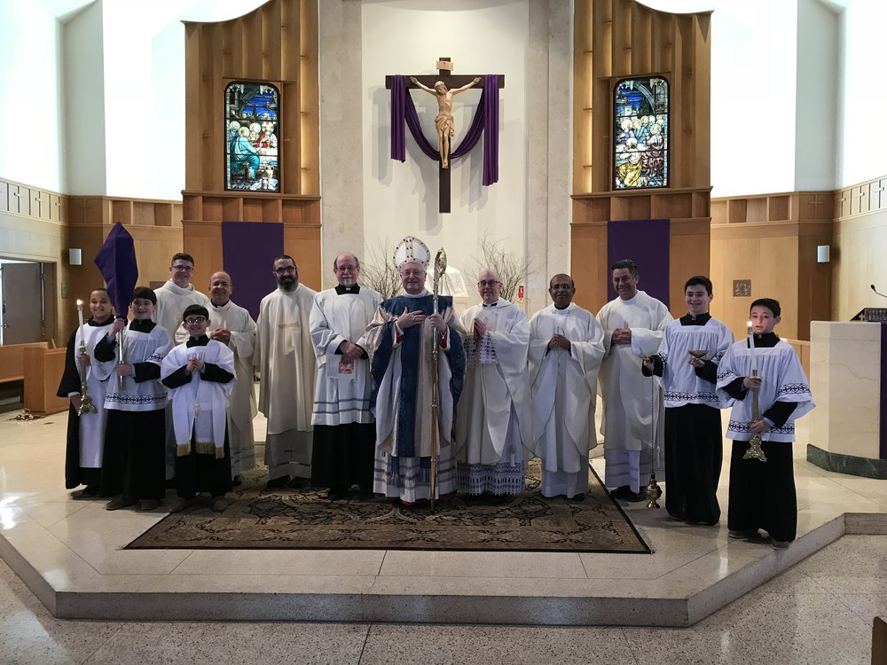 Bishop Evans and local clergy gather with the OLM Italian Altar Servers on St. Joseph's Day!