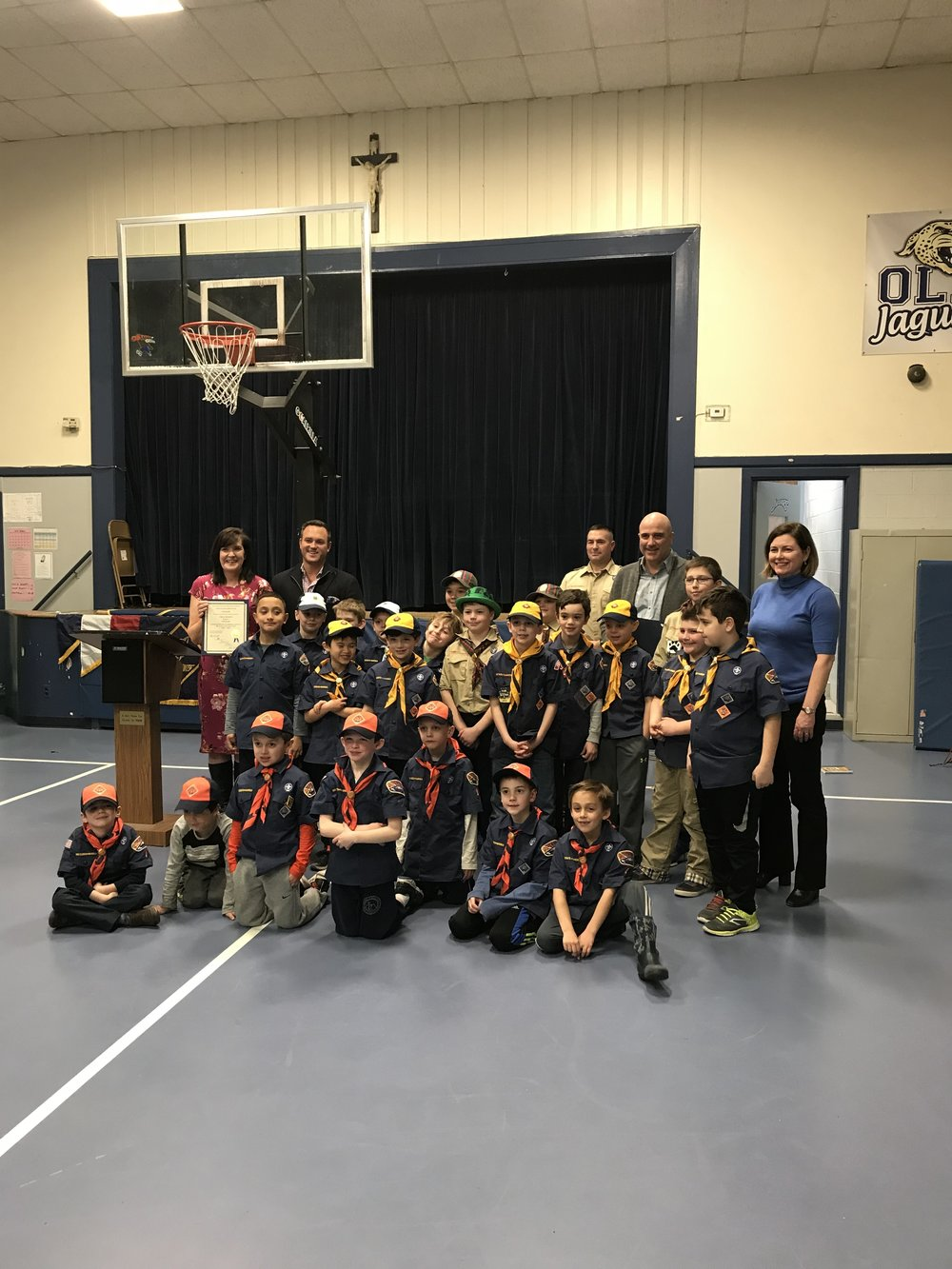 Pack 4 Scouts celebrate with members of the East Greenwich Town Council.