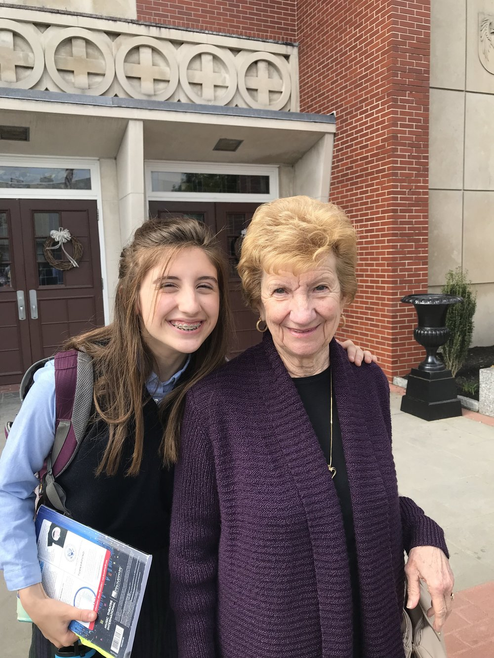 OLM 8th Grader Molly Wren poses with her Grandmother and OLM Parishioner, Bernice Broccoli.