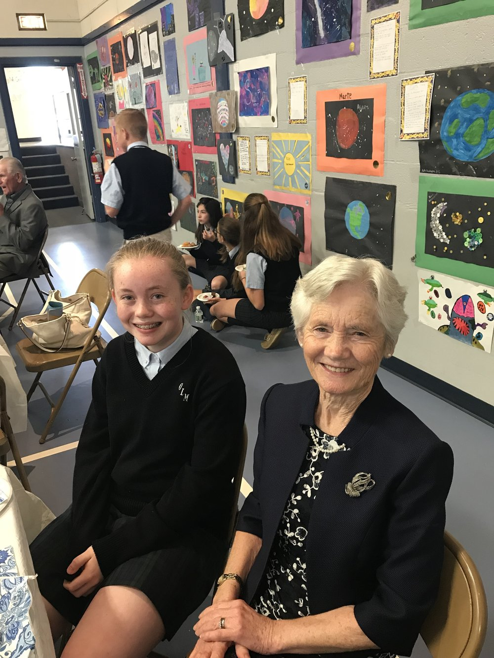 OLM 7th Grader Ali Campion poses with her Grandmother, Delia Campion, who traveled from Carlow, Ireland for the OLM School Grandparents Day!