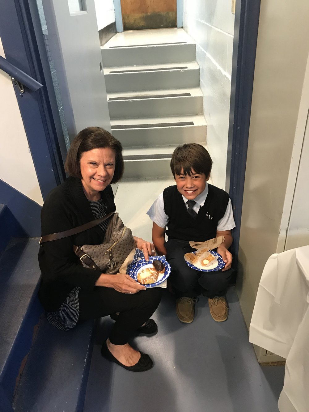 OLM 3rd Grader Ben Knudson enjoys some danish with his Grandmother, Debbie Knudson, who travelled from Scottsdale, Arizona for the celebration of OLM School Grandparents Day.