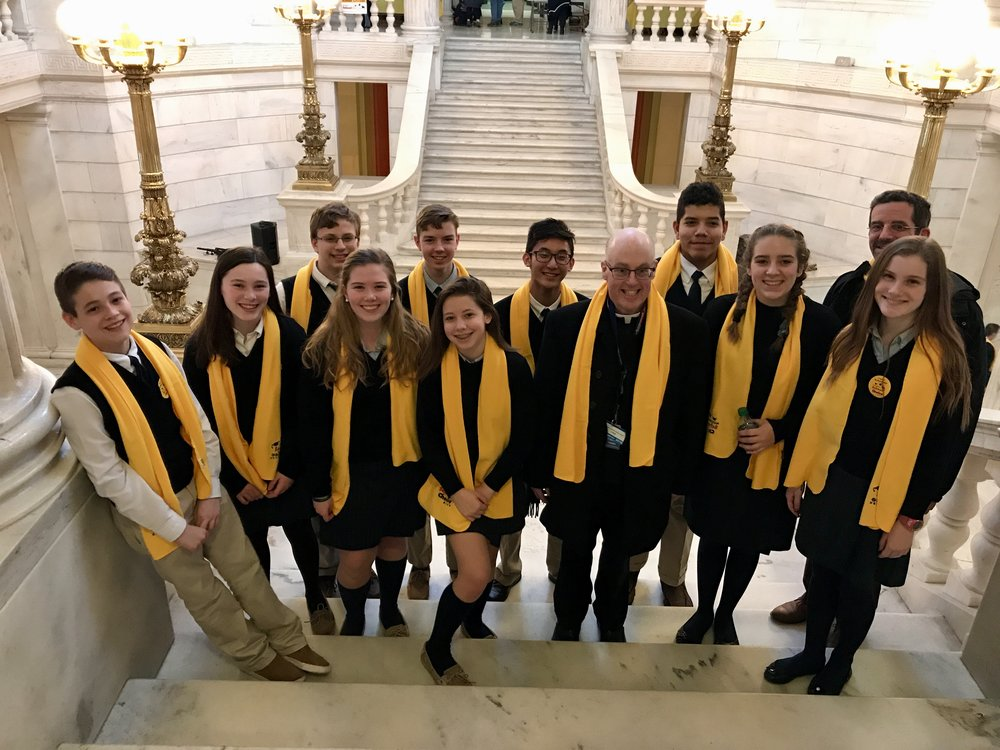 OLM School students and Fr. Healey advocate for School Choice programs at the RI Statehouse.